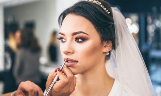Beautiful bride on makeup before wediing